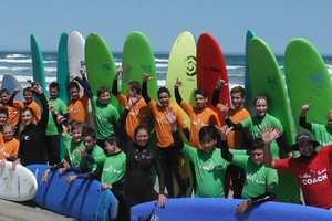 students poses after their surf lessons