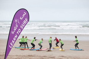 surf lessons during a school camp